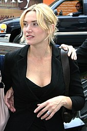 A casual Kate Winslet looks away from the camera.