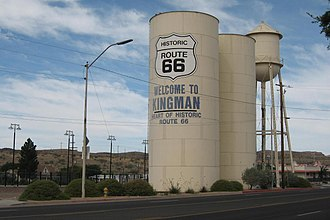 "Kingman, Arizona - A ""Welcome to Kingman"" sign on a water tower, marking its connection with Route 66"