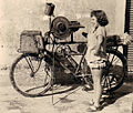 Knife sharpener's vehicle and tourist girl, Caorle 1958.JPG