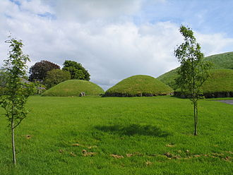 "Knowth - Main mound (""Site 1"", right) and smaller mounds at Knowth"