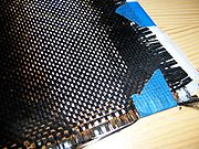 Fabric made of woven carbon filaments