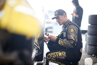 Fredric Aasbø - Fredric Aasbø checks tire pressures on his Rockstar Energy Drink Scion tC during 2015 competition