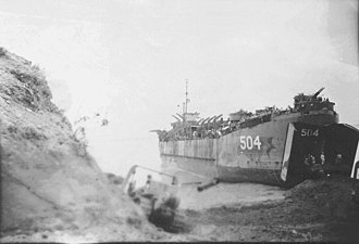 USS LST-504 - LST-504 beached at Chim Wan, Okinawa 8 June 1945 while being unloaded by Navy Seabees.