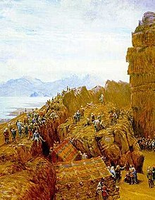 Painting of a rocky outcrop with people gathered around, a central figure stands at the top