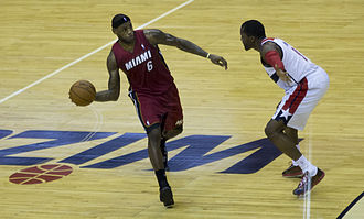 Point forward - LeBron James (left) brings the ball up the court.