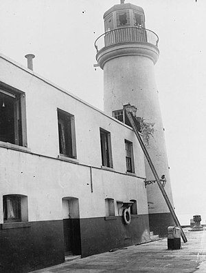 Raid on Scarborough, Hartlepool and Whitby - Damage to the Scarborough lighthouse is assessed after the raid.