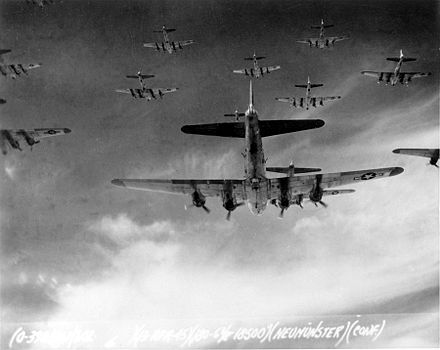 B-17 Flying Fortresses from the 398th Bombardment Group flying a bombing mission to Neumunster, Germany, on 13 April 1945. Living Legends.jpg