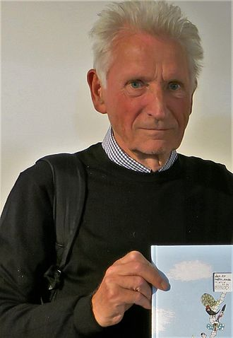 Louis Jensen - Louis Jensen holding the eleventh and final volume in his Square Stories series.