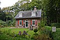 "Lovely house ""de Wolfskuil"" at Wageningen-Hoog with colourful windows - panoramio.jpg"