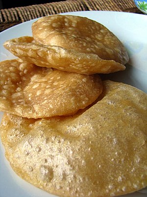 A deep-fried flatbread made of wheat flour tha...