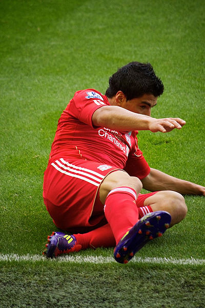 File:Luis Suarez slide Liverpool vs Bolton 2011.jpg