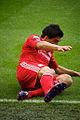 Luis Suarez slide Liverpool vs Bolton 2011.jpg