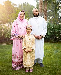 Dawoodi Bohra family in their religious attire.