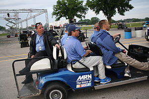 Motor Racing Network - 2013 Motor Racing Network announcers (from left to right) Buddy Long, Kurt Becker, Alex Hayden, Mike Bagley and Kyle Rickey riding in a golf cart at Road America.