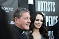 Madeleine Stowe and Father Rick Frechette at Artists for Peace and Justice 2014 Festival Gala.jpg