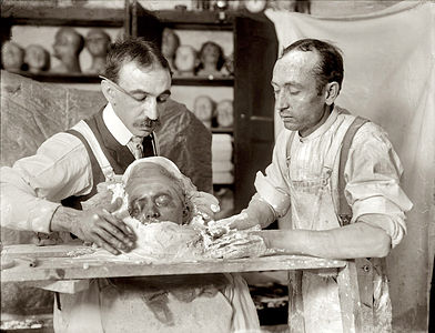 Two men making a death mask, New York, circa 1908
