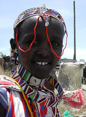 Culture of Kenya - Maasai woman in traditional headdress and attire.