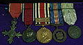 Medals at WM Police Museum MBE GeoV silver jubilee and long service.jpg