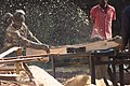 Men cut wood by using machine.jpg