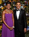 Michelle and Barack Obama pose in front of the official White House Christmas Tree (cropped).jpg