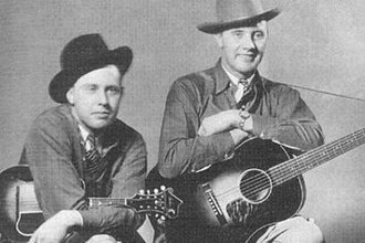 Country music - Bill and Charlie Monroe (1936). Bill Monroe (1911–1996) and The Blue Grass Boys created the bluegrass by the end of World War II.