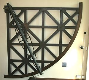 John Bird (astronomer) - Mural quadrant constructed as a frame mounted on a wall. This instrument was made by Bird in 1773 and is in the Museum of the History of Science, Oxford.
