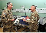 NOSC Phoenix and Anchorage Sailors discuss patient care at Role 3 Multinational Medical Unit, Kandahar Airfield, July 3, 2015 150703-N-SQ656-283.jpg