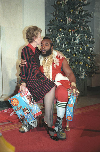 Mr. T - Mr. T portrays Santa Claus at the White House with First Lady Nancy Reagan in 1983.