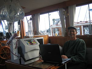 Home hemodialysis - NxStage System One cycler, being used for hemodialysis with bags of dialysate.