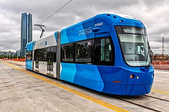 """Oklahoma City Streetcar - One of three color schemes used, seen here, is the """"Clear Sky blue"""". The other colors are """"Redbud"""" (magenta and pink) and """"Bermuda"""" (green)."""