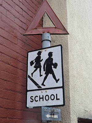Road signs in the United Kingdom - Old-style sign warning of a school ahead, still in existence in Glastonbury, Somerset.
