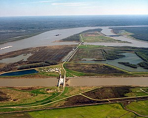 2011 Mississippi River floods - The Old River Control Structure complex.  View is to the east-southeast, looking downriver on the Mississippi, with the three dams across channels of the Atchafalaya River to the right of the Mississippi. Concordia Parish, Louisiana, is in the foreground, on the right, and Wilkinson County, Mississippi, is in the background, across the Mississippi on the left.