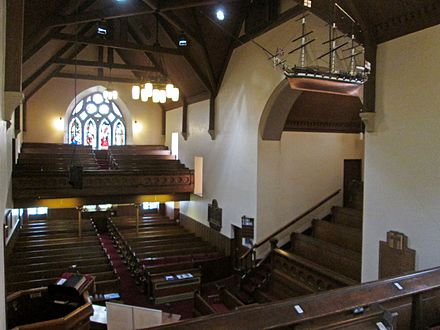 The Old West Kirk features a scale model of a 20-gun frigate above its Sailor's loft: the Laird's Gallery is on the right. Old West Kirk Farmer's Loft.jpg