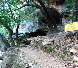 Chumash Painted Cave State Historic Park - Park setting with art protected by metal gate at cave entrance