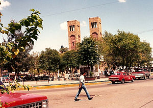 The Plaza Guillermo Baca in downtown Parral, showing the Searcher of Dreams Fountain and the Cathedral Shrine of Our Lady of Guadalupe, seat of the Diocese of Parral