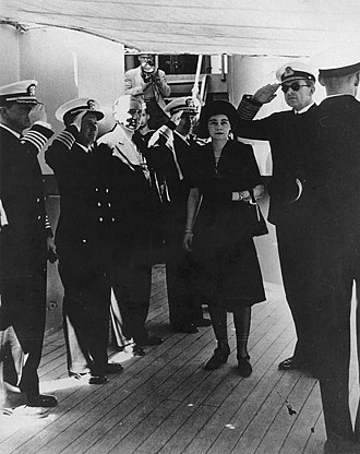Frederica of Hanover - Queen Frederica with King Paul, while visiting the USS Providence (CL-82), at Athens, circa May 1947