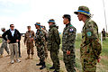 Peter R. Lavoy, left, the acting assistant secretary of defense for Asian and Pacific Security Affairs, meets with vehicle checkpoint lane instructors from Nepal, Germany, South Korea and Japan during a visit to 130806-M-MG222-014.jpg