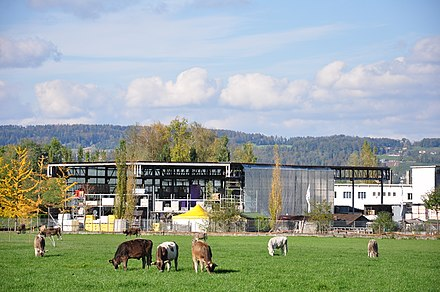 Farm land and industrial buildings side by side in Pfäffikon. Only a small percentage of the population is still active in agriculture in the canton.