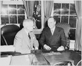 Photograph of President Truman at his desk in the Oval Office with Crown Prince Olav of Norway. - NARA - 200247.tif