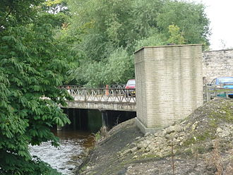 The railway line to Malton was carried over Pickering Beck with this bridge, which is beyond the car park and just across the A170 road, which now obstructs the former trackbed. Pickering Beck railway bridge.JPG