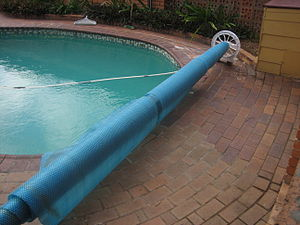 A rolled up pool cover used by a residential s...