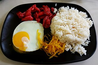 Tocino - Tosilog, a typical Filipino breakfast composed of tocino, fried eggs, sinangág (garlic fried rice), with atchara (pickled papaya) as a side dish