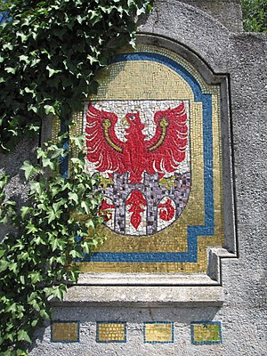 Merano - The town's coat of arms on the Postbrücke.