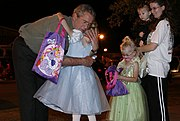 President George W. Bush hugs a trick-or-treater Tuesday, Oct. 31, 2006, during a Halloween visit