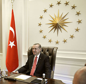 President of Turkey - President Recep Tayyip Erdoğan during a meeting, with the presidential seal and Turkish flag