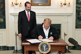 United States President Donald Trump signs the Coronavirus Preparedness and Response Supplemental Appropriations Act into law with Alex Azar on 6 March 2020. President Trump Signs the Congressional Funding Bill for Coronavirus Response (49627907646).jpg