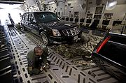 Presidential limousine loaded in aircraft