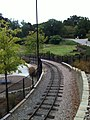 Pullen Park Childrens Railroad Oct 2013 Curve and retaining wall - panoramio.jpg
