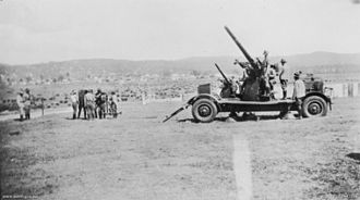 QF 3-inch 20 cwt - Guns on 4-wheeled trailers with Vickers Predictor at left, Australia c. 1937