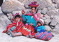 Quechua woman spinning and her children Peru.jpg